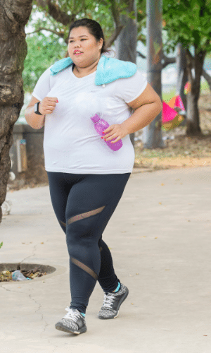woman running with a water bottle energized by bariatric snacks