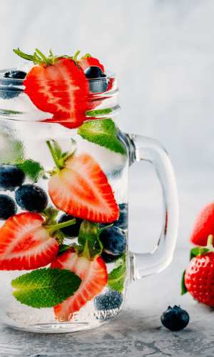 water with berries and mint soaking in it