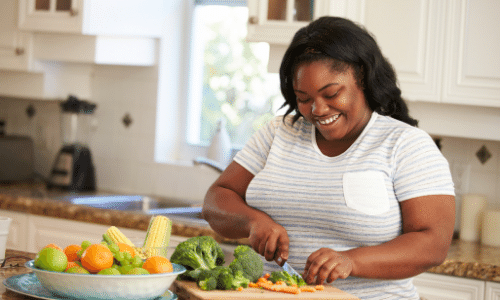 person chopping vegetables at a countertop