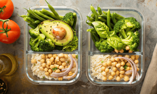 2 meals with chickpeas, rice, avocado, broccoli, and green beans. tomatoes on the side