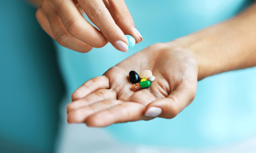 hands with supplements in palm